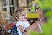 Caucasian grandmother and baby grandson smiling outdoors, Santa Fe, New Mexico, USA