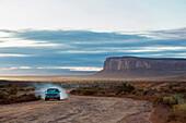 Car driving on dirt road in desert, Monument Valley, Utah, United States, Monument Valley, Utah, USA
