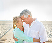 Caucasian couple hugging on beach, Santa Monica, California, USA