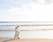 Caucasian couple walking on beach, Santa Monica, California, USA