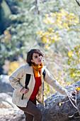 Mixed race hiker exploring forest, Santa Fe, New Mexico, USA