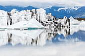 Vatnajokull Glacier reflected in still arctic water, Iceland, Vatnajokull Glacier, Iceland, Iceland