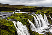 Waterfall flowing over rock formations in remote river, Southern Highlands, Iceland, Iceland