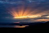 Sunbeams in cloudy sky over remote lake, Arba Minch, Ethiopia, Ethiopia
