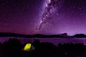 Milky Way galaxy over campsite in starry night sky, Mount Bromo, Surabaya, Indonesia