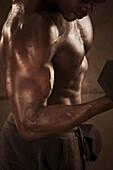African American man lifting weights, Saint Louis, MO, USA