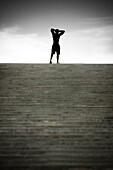 Black man stopping at top of stairs, Saint Louis, MO, USA