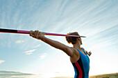 Caucasian athlete aiming javelin, Bainbridge Island, Wa, USA