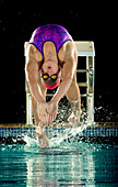 Caucasian swimmer diving off starting block, Bainbridge island, WA, USA