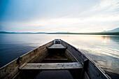 Dilapidated boat on remote lake, Chelabinsk, Ural, Russia