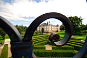 France, Burgundy, general view, front of the castle of Caumartin and garden through a detail wrought iron