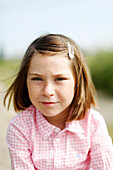 Portrait of a young girl, vegetal background