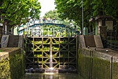 France, Paris, lock on Canal St Martin, footbridge in background