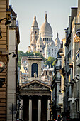 France, Paris, Montmartre, Sacré Cœur cathedral from rue Laffitte