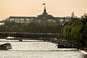 France, Paris, Grand Palais and its glass roof and Solferino footbridge over the Seine