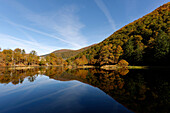 France, Midi Pyrenees, Ariege, Couserans, pond of Bethmale, autumn, trees, reflection