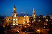 The San Francisco de Arequipa Cathedral (Catedral San Francisco de Arequipa) on the Plaza de Armas in Arequipa with the snows of Chachani volcano in the background by night in Peru,South America