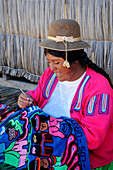 Woman weaving in a village of Titicaca lake in Peru,South America