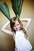 Little girl playing with leeks