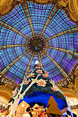 France. Paris 9th district. The Christmas tree of Galleries Lafayette under the dome
