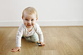 A baby boy walking with 4 legs