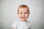 Portrait of a smiling 11 months baby boy