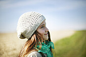Portrait of a 7 years old girl, she is smiling on a country lane