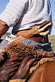 Close up of knife in Hispanic cowboy's waistband