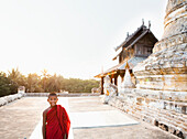 Asian boy smiling outside temple