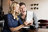 Caucasian couple using digital tablet together