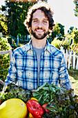 Caucasian man harvesting vegetables in garden