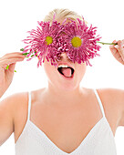 Portrait of silly woman covering eyes with flowers
