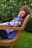 Mixed race woman relaxing in backyard