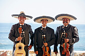 Hispanic mariachi band smiling together