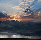 Airplane flying in dramatic sky