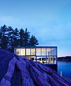 Exterior of modern house near lake