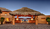 Thatched roof over stone walkway at resort, Cabo San Lucas, BCS, Mexico