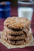 Stack of Soft Ginger Cookies With Glass of Milk