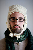 Man with Beard and Eyeglasses Wearing Hat and Scarf, Portrait, Close-Up