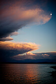 Dramatic Cloud Formation over Water at Sunset