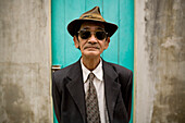 Vietnamese Man in Suit, Hat and Sunglasses