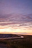 BADLANDS NATIONAL PARK, SOUTH DAKOTA, USA. A boardwalk winds through the distance in Badlands National Park, South Dakota.