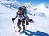 Mountain ranger Brian Scheele on this way to Windy Corner on Mount McKinley, also know as Denali, in Alaska. He is pulling a sled, that together with his heavy backpack is containing all the gear like tents, clothing and food.     Every climbing season Hi