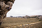 Athletic male rope climbing on a cliff in City of Rocks Idaho