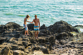 Couple are walking on the beach in Bali. Indonesia