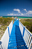 A blue and white boardwalk leads to Playa Pilar beach on Cayo Guillermo, Cuba.
