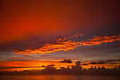 A beautiful sunset full of color as seen from  Playa La Jaula beach, Cayo Coco, Cuba