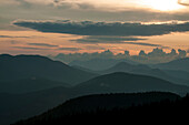 Sunset and clouds over the White Mountains of New Hampshire.