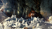 Panoramic image of ice pillars and glacial water in the middle of the Ice cave on Mount Durmitor.