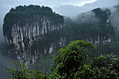 After rains pass and clouds rise from the bottom of the gorges in Sanqiao or the Three Natural Bridges large limestone cliffs appear unveiling a spectacular landscape